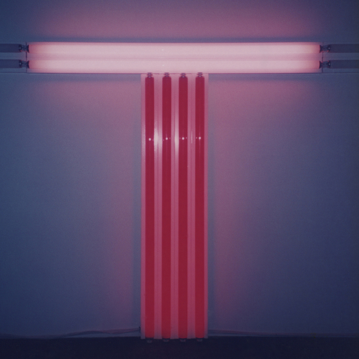 Untitled (To Don Judd, colorist)|red and pink fluorescent lights|137 x 122 x 10 cm|1987