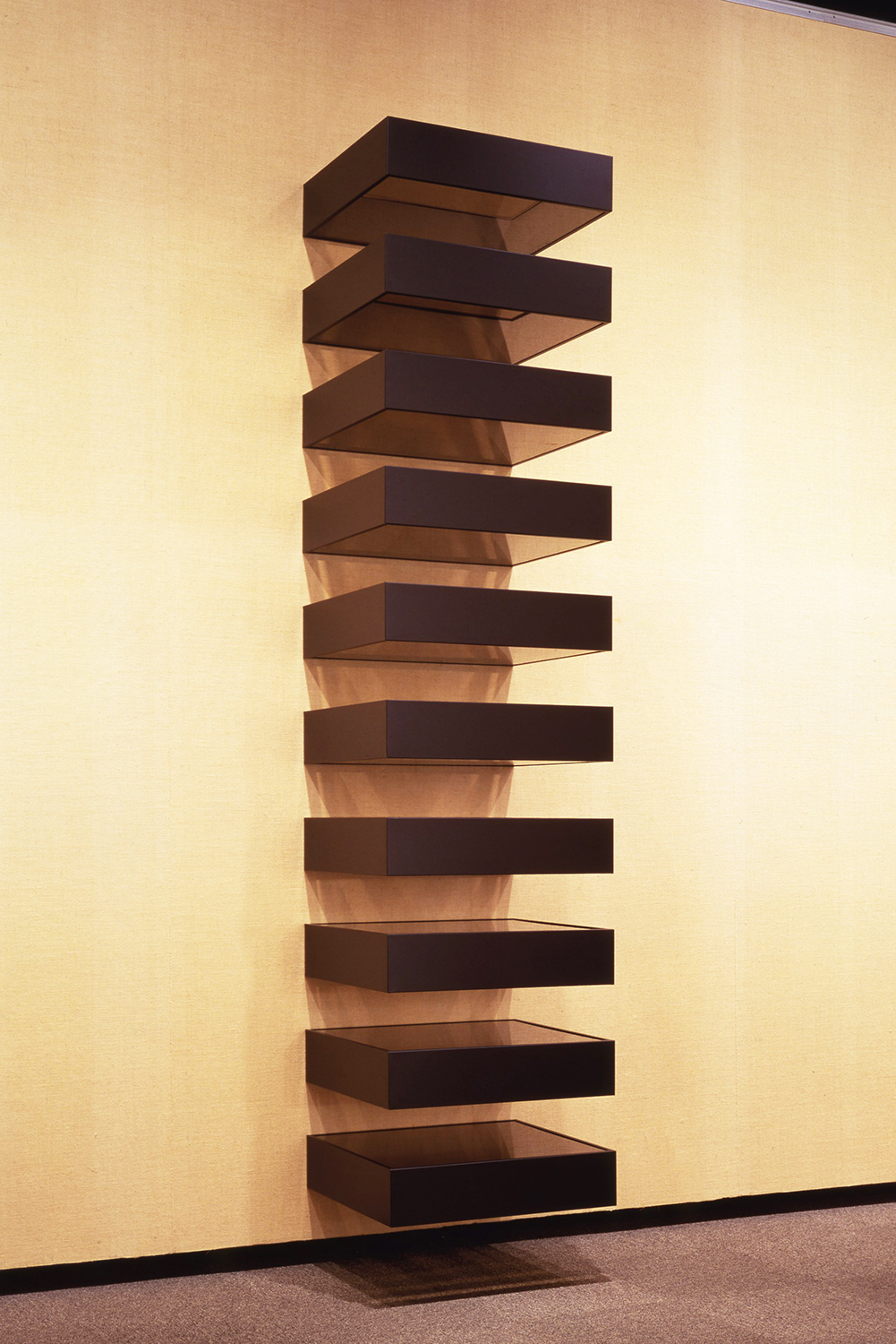 Untitled 1990|blacked anodized aluminum with bronze plexiglass top and bottom (10 units) |15 x 68 x 61 cm each<br>Collection: Shizuoka Prefectural Museum of Art