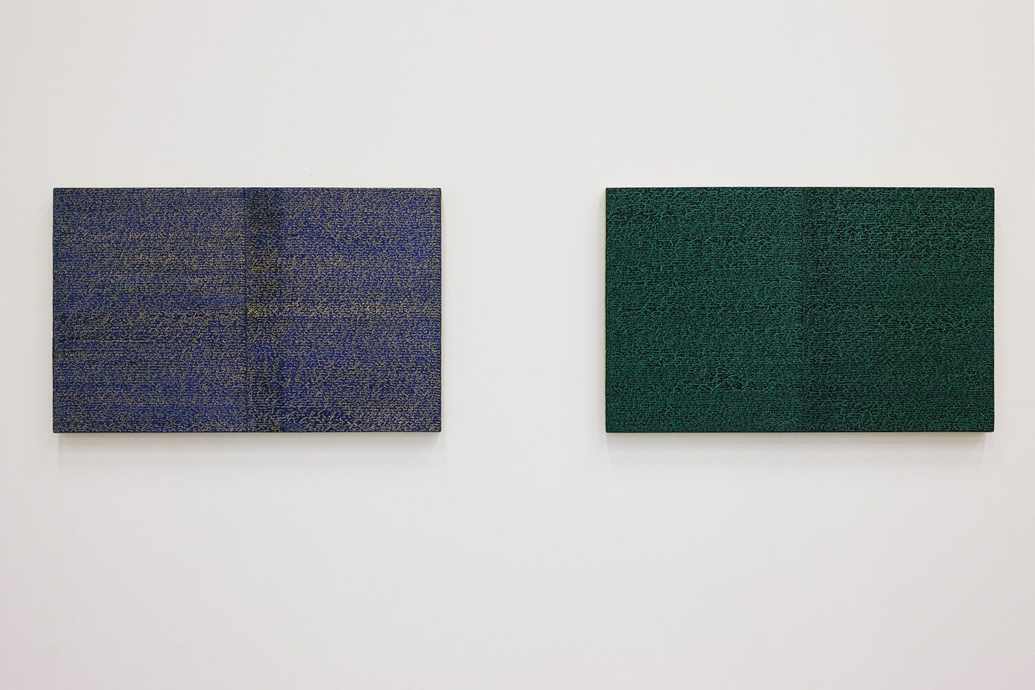 'Open Book yellow-blue'  (left) &  'Open Book green-green' (right)<br>Oil and Amber on canvas over panel, 37 x 60 cm, 2008 each