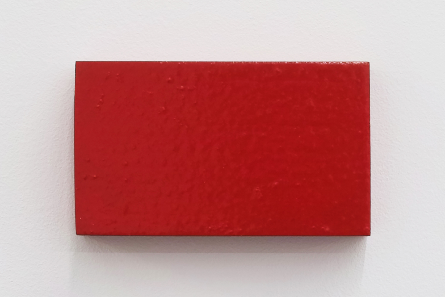 Text No. 519 (red)<br>acrylic, ink on wood,  60 x 101 x 22 mm,  2004