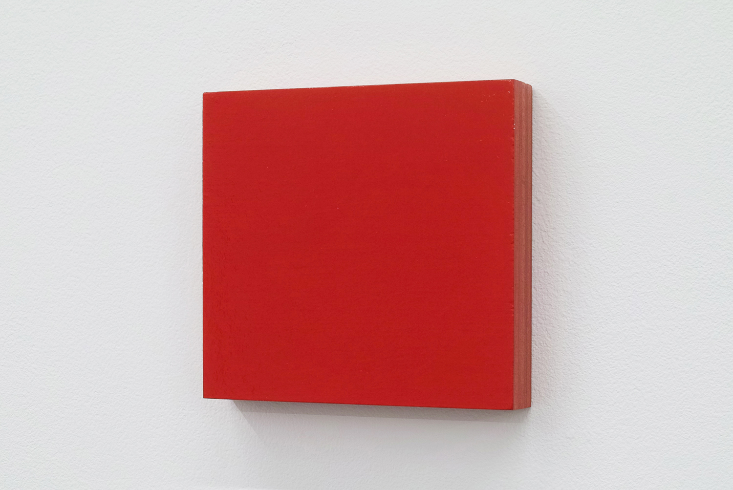 Text No. 265 (untitled red)<br>acrylic on plywood,  100 x 106 x 18 mm,  2002