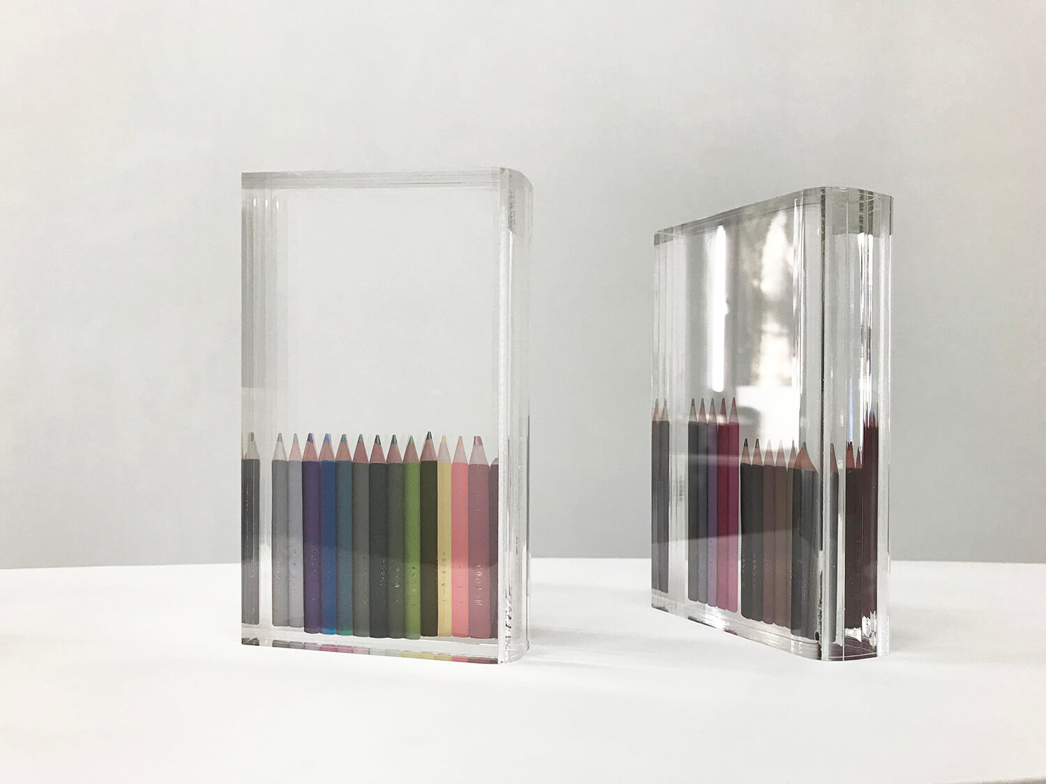 libraly-color pencil<br>acrylic and transfer seal<br>105 x 180 x 40 mm each<br>2019